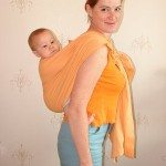 Положение на спине у мамы в слинге с кольцами